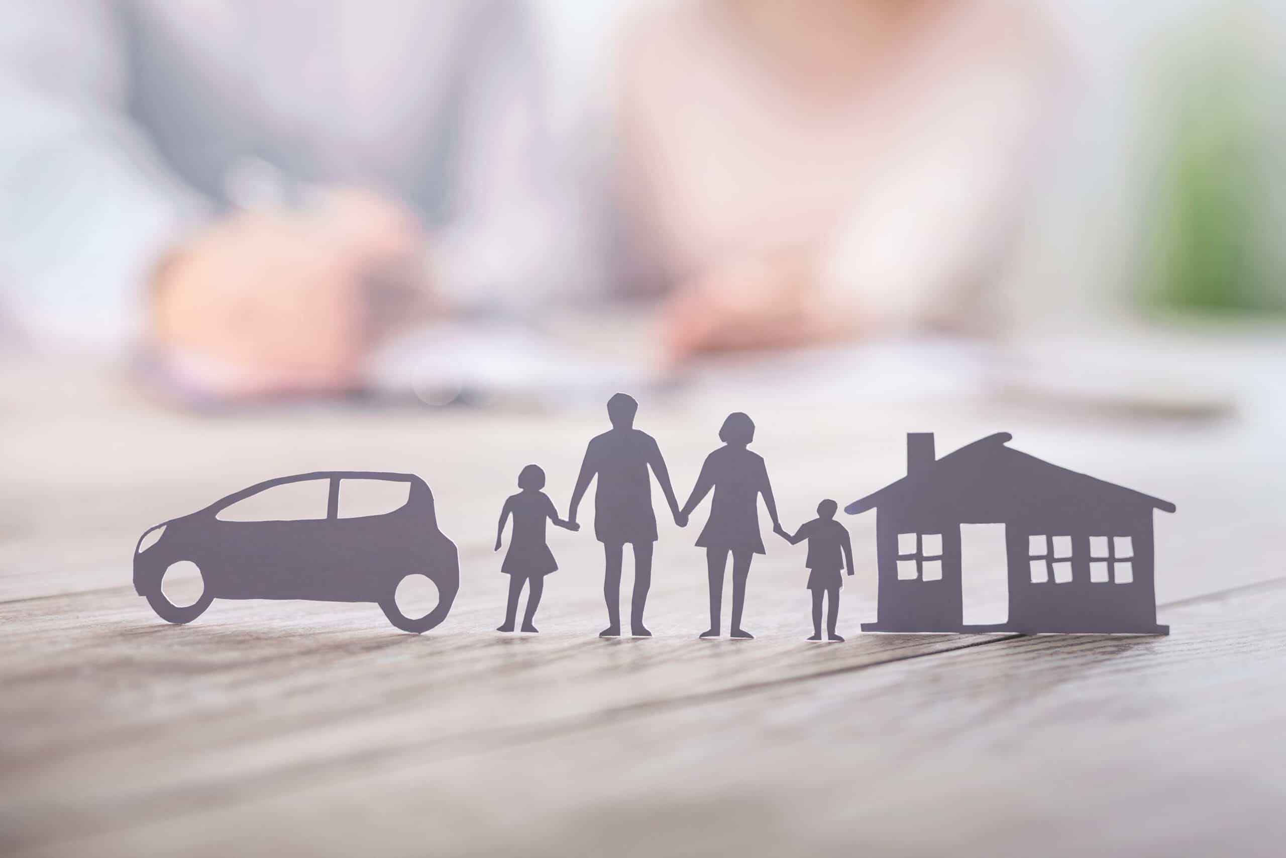 Paper Cut-outs Of A Family, Car, And House
