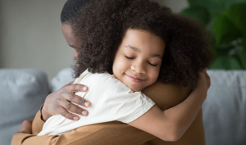 Young Child Hugging Her Father